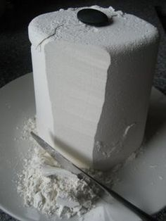 Flour Game - pack tightly flour into tall container -> unmolding the flour tower by turning upside down onto plate -> Lay a large button on top of flour tower -> then take turns slicing away at tower with butter knives to see who will be the first person to make the button fall from the top.