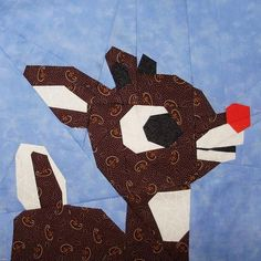 Paper Pieced Rudolph Block - The Paper Pieced Rudolph Block is a Christmas quilting pattern that looks absolutely adorable and is so intricate on its own that it would make a cute wall-hanging or small pillow. Whether you decided to use paper piecing patterns to create a complicated quilt or use one block to sew up a panel quilt, this Christmas idea is guaranteed to be a new fave.