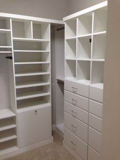 Beau Closet Creations White Closet With Hamper Built In.