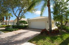 """New Listing: Highly sought after community in Palm Beach Gardens """"The Isles."""" This 2 bdrm, 2 bath, 2 car garage townhome has 1513 of living sq. ft. The extended screened lanai with tranquil views of the lake will make this your ideal retreat. Freshly painted interior, accordion hurricane shutters, the bedrooms are 2 separate suites, custom decorative front door, open floor plan, oversized laundry room with utility sink and cabinetry."""