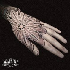 Mandala and dotwork hand tattoo by Tomm Birch, in our Heart for Art Tattoo Studio, Manchester.  #tattoo #mandala #dotworktattoo