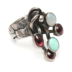 Sterling Silver ring with ruby and turquoise cabochons. Circa 1960.  Measures 1 1/4″ across the front from top to bottom.