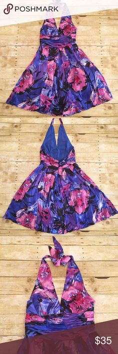 Blue/purple Adrianna Pepell occasions dress, 10 Absolutely stunning and bright dress by Adrianna Papell. Occasions addition. No wear that I see, in excellent condition! Halter neck tie. Very full skirt, fully lined. A mix of blues,purples, black, and pink. Low cut. Perfect for showing off your awesome self! Total length-approximately 39 inches, bust- approximately 15 inches, waist- approximately 13 inches. Adrianna Papell Dresses Midi
