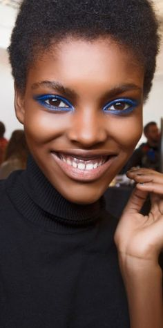 For nights when you're feeling really bold, a bright blue eye is the best way to get noticed for all the right reasons. Apply a metallic blue shadow on the entire lid, then trace the lower lash line for some extra oomph. Keep the rest of your face clean and simple—let your eyes do all the talking.