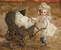 Bread and Roses - Auction - July 26, 2016: 188 German All-Bisque Blue Stocking Mignonette with Silver Carriage and Baby