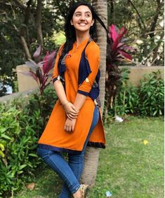 Image may contain: 1 person, standing, tree, outdoor and nature Indian Fashion Dresses, Indian Designer Outfits, Teen Fashion Outfits, Girl Fashion, Girl Outfits, Girl Photo Poses, Girl Photography Poses, Girl Poses, Kurti With Jeans