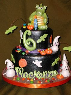 Happy Birthdayween! - This cake was indpired by a cake done by Tammy Moore. It was for a little girls Halloween Birthday Party! Covered in Fondant and air brushed black. All the figures are made from Gumpaste or Fondant. It took a lot of time but was so fun!