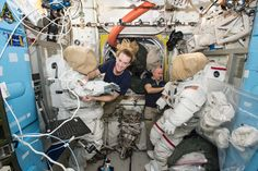 Astronauts Kate Rubins and Jeff Williams Prepare For a Spacewalk Expedition 48 crew members Kate Rubins (left) and Jeff Williams (right) of NASA outfit spacesuits inside of the Quest airlock aboard the International Space Station. Rubins and Williams will conduct a spacewalk on Friday Aug. 19 2016 to install a new docking port that will enable the future arrival of U.S. commercial crew spacecraft.