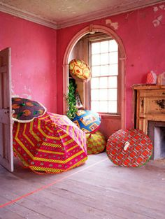 Love patterned, colorful umbrellas. Love the rain, too, so that's a happy combo. This is an interior styled by Irina Graewe.
