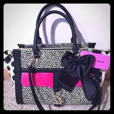 """Betsey Johnson purse Adorable Betsey Johnson tote. Can be worn as a crossbody. Comes with a Detachable strap. Gold tone hardware. Front zipper pocket. Roomy inside with zipper pocket and 2 tech open pockets. Cute floral lining. Measures apx. 16""""Wx9""""Hx6.5""""D. NWT. No trades please. Betsey Johnson Bags Totes"""