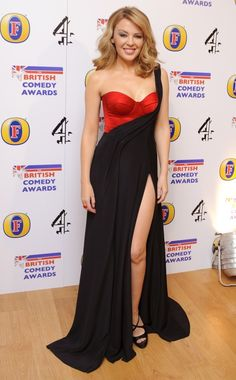 She may be tiny but they go on forever! Kylie Minogue shows off a lot of leg in two-toned dress at the British Comedy Awards Kylie Minogue, Melbourne, Demi Lovato, Divas, British Comedy, Female Singers, Celebs, Celebrities, The Dress