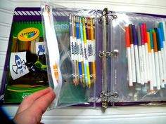 Organize your art supplies into a 3-ring binder with clear pencil pouches.  Small enough for kids to carry and portable enough to take in the car on a moment's notice.