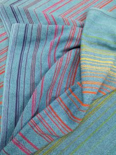 """""""Color Wheel Blue""""  4.1m x 66cm. Plain weave structure with a Royal blue weft. Handwoven cotton/cotolin yardage. Handmade fabric created on a loom at Cloth of Kin Weaving Studios. Our KIN cloth is soft, lightweight, durable and unhemmed. It can be made into baby wraps, baby blankets, wall hangings, pillow cases, place mats, table runners or clothing.  (Made in Canada)"""