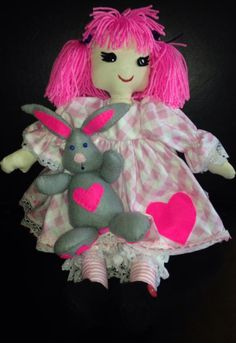this is poppy my hand made doll she also has her own little pet rabbit called cookie