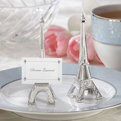 These elegant mini eiffel tower place card holders make great wedding favors for couples jet-setting to France for a destination wedding.  These finely detailed place card holders can be used as table decorations as well as favors.  Sold in sets of 4.