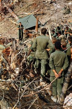 25 Apr 1968, Quang Tri, South Vietnam --- A newly cleared area near Quang Tri serves as an outside chapel as members of the US 1st cavalry hold services for comrades who had been killed in the area. Conducting services is Chaplain James Ware of Mansfield, Ohio.