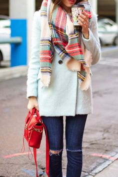 Mint coat, plaid scarf, and a red bag