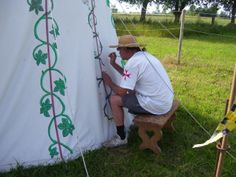 painting our medieval tent - could get an old white bed sheet and paint OoA on the side?