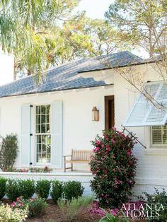 House Tour:Sea Island - Design Chic love the light blue shutters &contrast of dark wood door