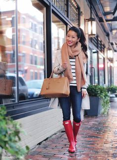 Rainy day casual outfit of basics - camel scarf, Hunter boots, striped tee, Burberry trench coat