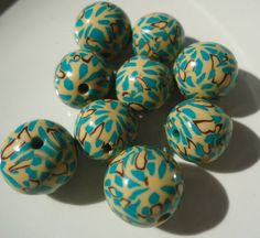 handmade fimo clay beads, with canes and fimo clay, baked, sanded, and glazed 3 times