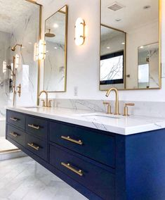 Modern bathroom with brass and navy