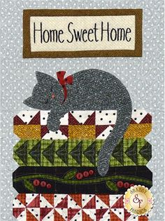 "Purrfectly Pieced - Home Sweet Home Pattern: Purrfectly Pieced - Home Sweet Home is the Block 4 pattern of the Purrfectly Pieced quilt by Bonnie Sullivan. This quilt block features a sleeping cat on a stack of quilts! Finished quilt block measures 12"" x 16"".If you would like the full pattern set click here to purchase Purrfectly Pieced - Set of 5 Patterns."