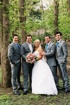Stunning photo of the groomsmen with the bride and groom. Suits, Wedding, Bridal party.
