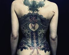 This corset tattoo has a heart at its center, surrounded by feminine tattoo designs like lace and ribbons. Description from pinterest.com. I searched for this on bing.com/images