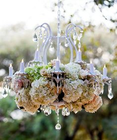 A floral chandelier sparkles during a @Four Seasons Hotel Austin ceremony.