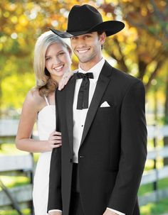 1 Button Classic Western Cowboy Tuxedo in Black. All you need is to put on a hat, and throw on your bolo tie and you'll be good to go! Pants come 6 inches smaller than jacket, and can adjust 2 inches out or 4 inches in. #PromTuxedo #Tuxedo #BlackTuxedo #WeddingTuxedo #PromTux #WeddingTux #Tux #Wedding #Prom