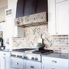 How to Choose the Perfect Farmhouse Paint Colors With its beautiful cabinetry, that gorgeous rustic hood fan and all that beautiful brick, this incr Rustic Kitchen Cabinets, Farmhouse Style Kitchen, Modern Farmhouse Kitchens, Kitchen Backsplash, Kitchen Decor, Kitchen Rustic, Kitchen Ideas, Kitchen Counters, Diy Kitchen