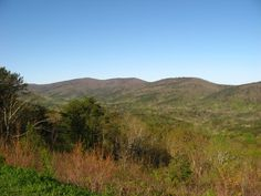Cheaha Mountain is the highest mountain in the state of Alabama at 2,407 feet. The highest summit is the knob on the left, and the summit tower can be viewed if looked at closely.