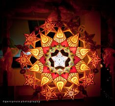 """""""Parols are ornamental star-like Christmas lanterns from the Philippines. They are traditionally made out of bamboo and paper and come in various sizes, shapes and designs; however, their star-shape façade and basic design remain dominant.  The shape is said to be inspired by the star on the Nativity of Jesus that guided the Magi to the manger. It also symbolizes the victory of light over darkness and the Filipinos' hope and goodwill during the Christmas season"""""""