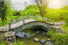 24 Incredible and Varied Garden Bridge Designs - Garden Lovers Club Pond Bridge, Garden Bridge, Ponds Backyard, Backyard Landscaping, Pond Design, Garden Design, Lake Garden, Natural Pond, Bridge Design