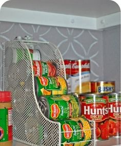 Space Saver--use magazine holders to store your canned goods and free up room in your cupboards!