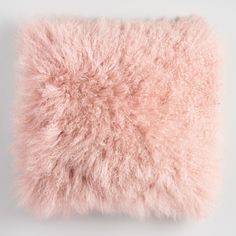 You'll adore how the heavenly softness and blush hue of our genuine Mongolian lamb fur pillow with matching faux suede back brings a boutique look to your space for an exquisite value.