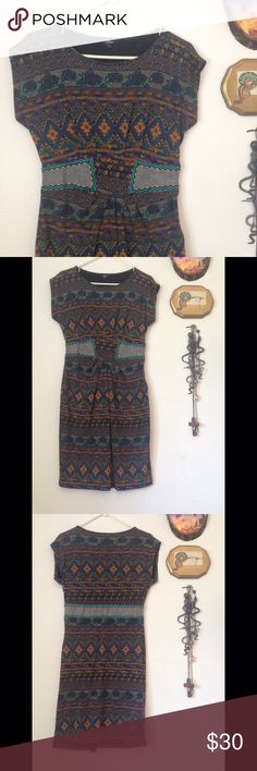 🆕Vintage curve hugging tribal print bodycon dress Ribbed knit curve hugging tribal print dress with embroidered denim waistband. Stretchy and oh so flattering. The waistband acts like a belt and accentuates the waist giving you that bootylicious look. Beautiful tribal print. Good vintage condition. Labeled size medium, could also work for a large, equivalent to a size 8/10. Vintage Dresses Mini