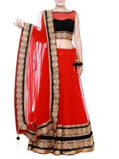 Crimson net lehenga with gold and silver metallic embroidery highlighted with studs and gilded lace. Teamed with matching blouse with black velvet yoke and net dupatta further adorned with tassels.
