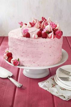 Raspberry Pink Velvet Cake: Covered in a pretty-in-pink raspberry cream cheese frosting, this fluffy pink velvet cake is also topped with edible flowers and sweet meringues. Click through to find more simple ideas for pretty Mother's Day cakes.