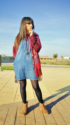 Veronica in black tights, denim dress, red patterned scarf and brown boots