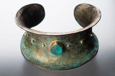 "Judith Altruda - Electra Cuff Materials: shibuichi, 22KT gold, sea glass, silver Dimensions: 2""X6""  Etched shibuichi alloy with 22kt gold and sea glass. Photo credit: Marcy Merrill"