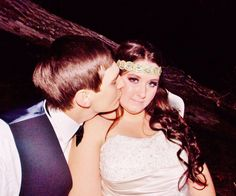 Beautiful married couple! #nightwedding #bridalmakeup #weddingphotography #bridalhair #bohemian #pinkpewter #headband #handsomegroom #weddinghair #weddingmakeup #brideandgroom #beautifulbride #longhair #bridalphotography   #weddinginlove #rusticwedding #weddinginnature #weddingkiss
