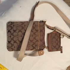 On Hold Coach Cross body and small wallet These are pre loved items with some wear. Since the tan and brown coloring the imperfections don't stand out when wearing. All seems are in tact. No stains inside nor holes. The inside of both look almost new. Just well loved with plenty of life left. Perfect for someone wanting a name brand set for not a lot of money. Strap on purse almost like new Coach Bags Crossbody Bags