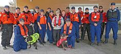Coast guard members wear lifejackets at Ogdensburg Marina to promote boat safety awareness