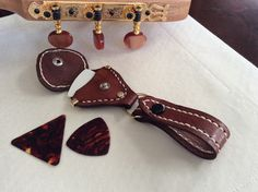 A personal favorite from my Etsy shop https://www.etsy.com/listing/259575642/guitar-pick-buddy-makes-a-perfect-gift