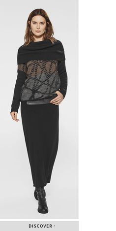 Black skirt and black grey pullover with a crisscross line print for added interest by Belgian fashion designer Sarah Pacini