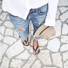 White shirt, ripped blue jeans, Havaianas flip flops and straw hat - Summer outfit inspiration and styling ideas