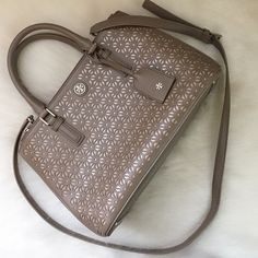 Tory burch Robinson floral perforated handbag Used a couple of times, great condition ! Love this handbag. Gray handbag with light pink floral print (perforations). NOT TRADES please don't ask. Moving out of the country soon and I need to sell this Tory Burch Bags