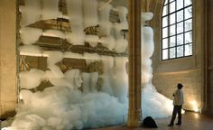 """In a gorgeous Cistercian monastery in Paris – one that dates back to the 13th century – sits Michel Blazy's astonishing kinetic installation called Bouquet Final. The installation contrasts the stability of the renovated church with ever changing foam bubbles cascading around metal scaffolding like gigantic strips of cotton candy to show the fragility of life."""